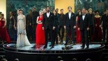 Aaron Tveit, Anne Hathaway, Amanda Seyfried, Eddie Redmayne, Hugh Jackman, Samantha Barks, Sacha Baron Cohen and Russell Crowe perform at the 2013 Oscars at the Dolby Theatre in Los Angeles on February 24.