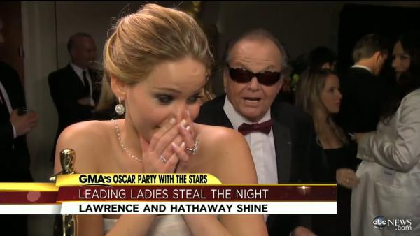 Jennifer Lawrence appears in an interview with George Stephanopoulos at the Oscars on February 24, 2013. Jack Nicholson can be seen peeking from behind the award winning actress. - Provided courtesy of ABC
