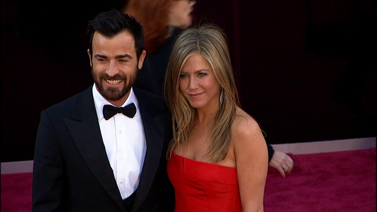 Jennifer Aniston walks the red carpet with Justin Theroux at the 2013 Oscars on Sunday, February 24.