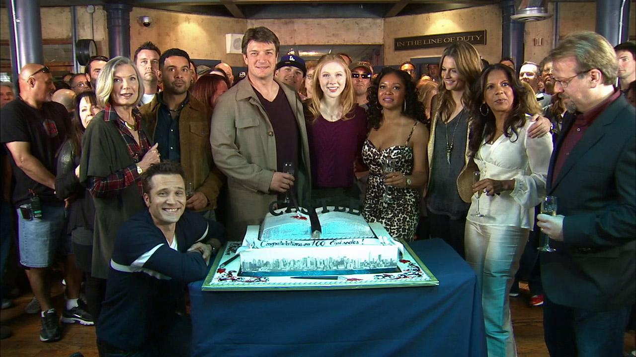 The cast of Castle appear in a photo from their 100th episode celebration on Feb. 27, 2013.
