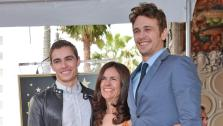 Actor James Franco (R), his brother Dave Franco (L) and his mother Betsy Franco (C) attend a ceremony honoring James Franco with a star on The Hollywood Walk of Fame on March 7, 2013 in Hollywood, California. - Provided courtesy of Alberto E. Rodriguez/WireImage