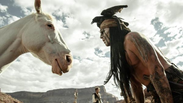 Johnny Depp challenges The Lone Rangers horse to a staring contest in a scene from Walt Disneys 2013 movie The Lone Ranger. - Provided courtesy of Walt Disney Pictures