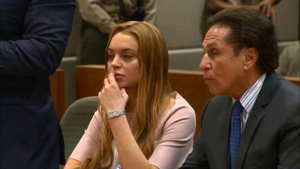 Lindsay Lohan appears at a Los Angeles court on March 18, 2013 at a trial over a 2012 car crash case.