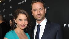 Ashley Judd and Gerard Butler pose at the LA premiere of Olympus Has Fallen at the ArcLight Theatre on Monday, March 18, 2013 in Los Angeles. - Provided courtesy of AP / Jordan Strauss
