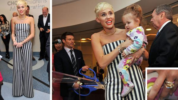 Miley Cyrus holds patient Janessa Martinez, 20 months old, of CHOC Childrens Hospital at the opening of the Ryan Seacrest Foundations multimedia broadcast center Seacrest Studios at the center on March 22, 2013 in Orange, California. - Provided courtesy of OTRC