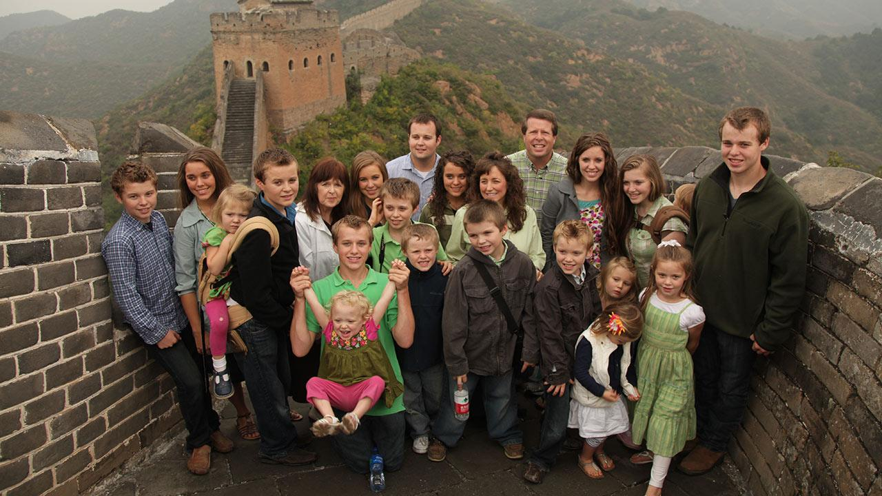 The Duggars appear in a publicity photo for a March 26, 2013 episode of 19 Kids and Counting: Duggars Do Asia, in which they visit China.
