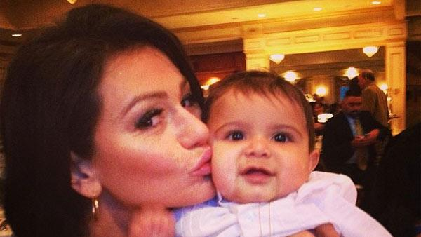 JWoww kisses Snookis son, Lorenzo, after his baptism on Sunday, March 24, 2013. - Provided courtesy of twitter.com/JENNIWOWW/status/315971708467154945 / instagram.com/p/XQlKJEqS4_/)