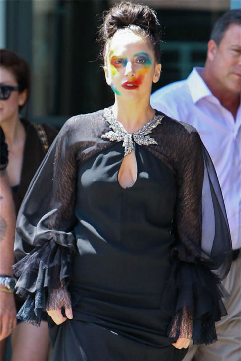 Lady Gaga walks on a Los Angeles street after taping an interview for the syndicated KIIS-FM radio show 'On Air With Ryan Seacrest' on on Aug. 12, 2013.