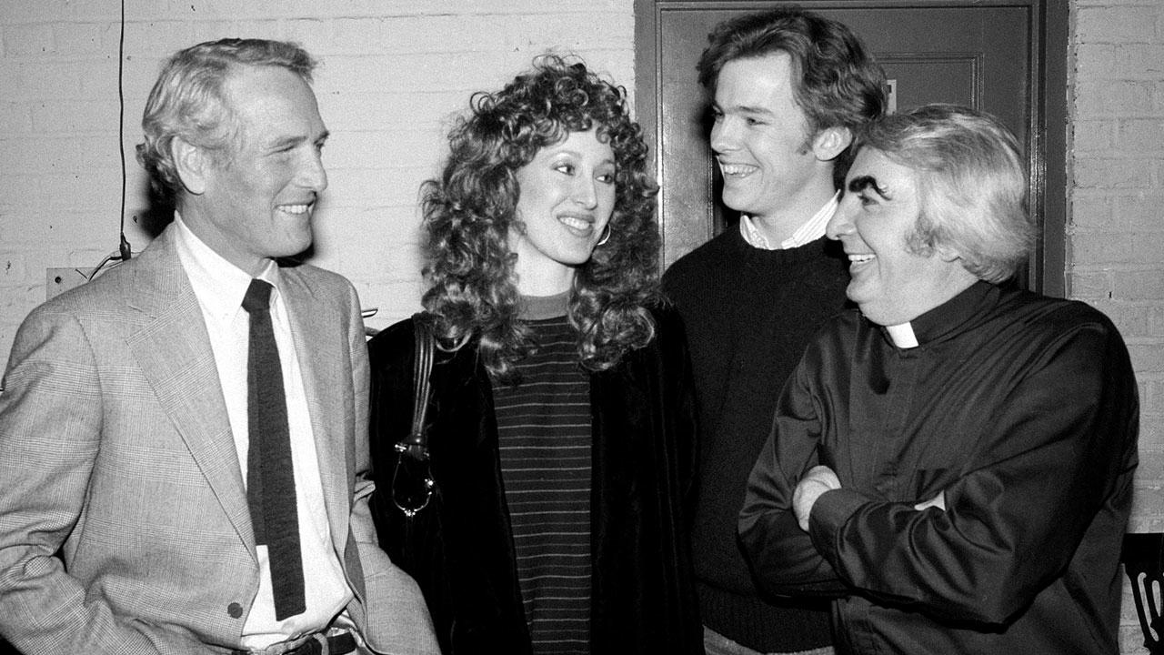 In this March 3, 1982 file photo, actor Paul Newman, left, and his daughter Susan visit backstage at the Booth Theater to chat with actors Michael OKeefe, second from right, and Milo OShea, far right, who appear in the play Mass Appeal, in New York.AP Photo/Carlos Rene Perez, File