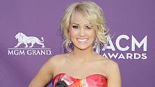Carrie Underwood appears on the red carpet at the 48th annual Academy of Country Music (ACM) Awards. The ceremony was co-hosted by Luke Bryan and Blake Shelton and was broadcast live from the MGM Grand Garden Arena in Las Vegas on April 7, 2013. - Provided courtesy of Francis Specker / CBS