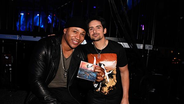 LL Cool J and Brad Paisley appear backstage at the ACM Fan Jam at The Orleans in Las Vegas, Nevada. The 48th annual Academy of Country Music Awards took place at the MGM Grand Garden Arena in the city on April 7, 2013 and aired live on CBS. - Provided courtesy of Bret Hartman / CBS