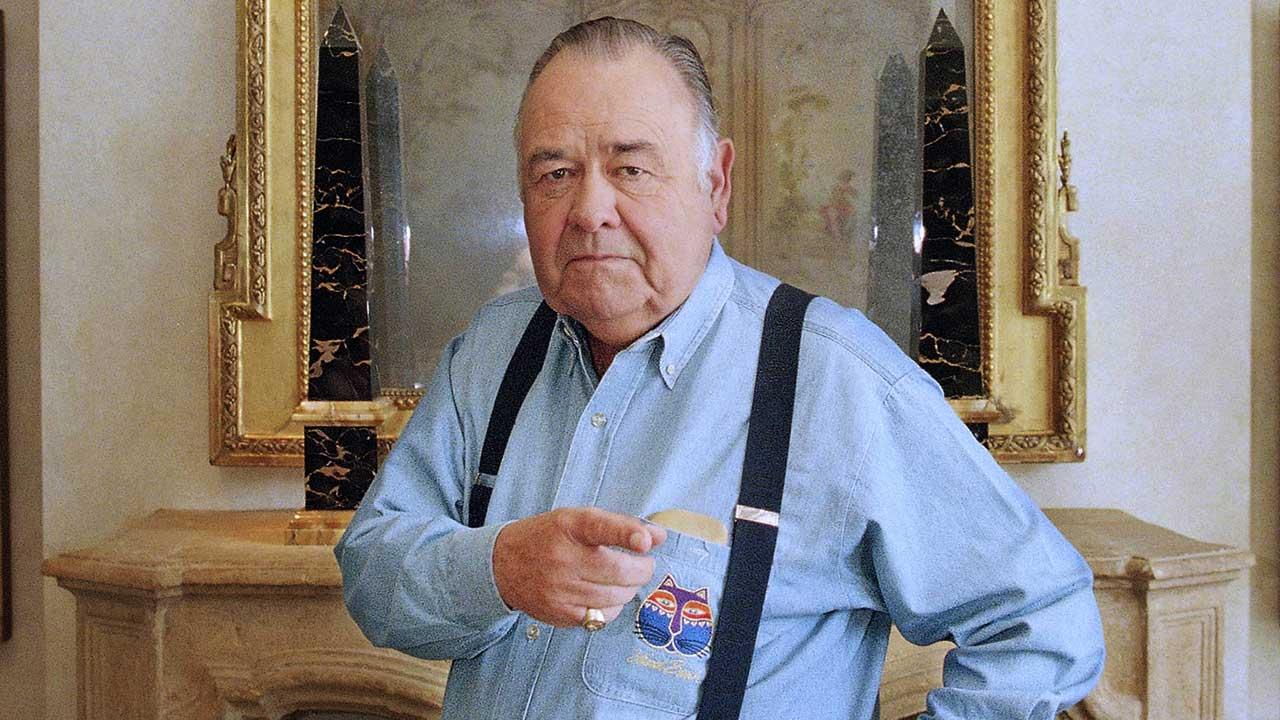This May 6, 1997 file photo shows comedian Jonathan Winters posing at a hotel in Beverly Hills, Calif.AP Photo/Damian Dovarganes, file