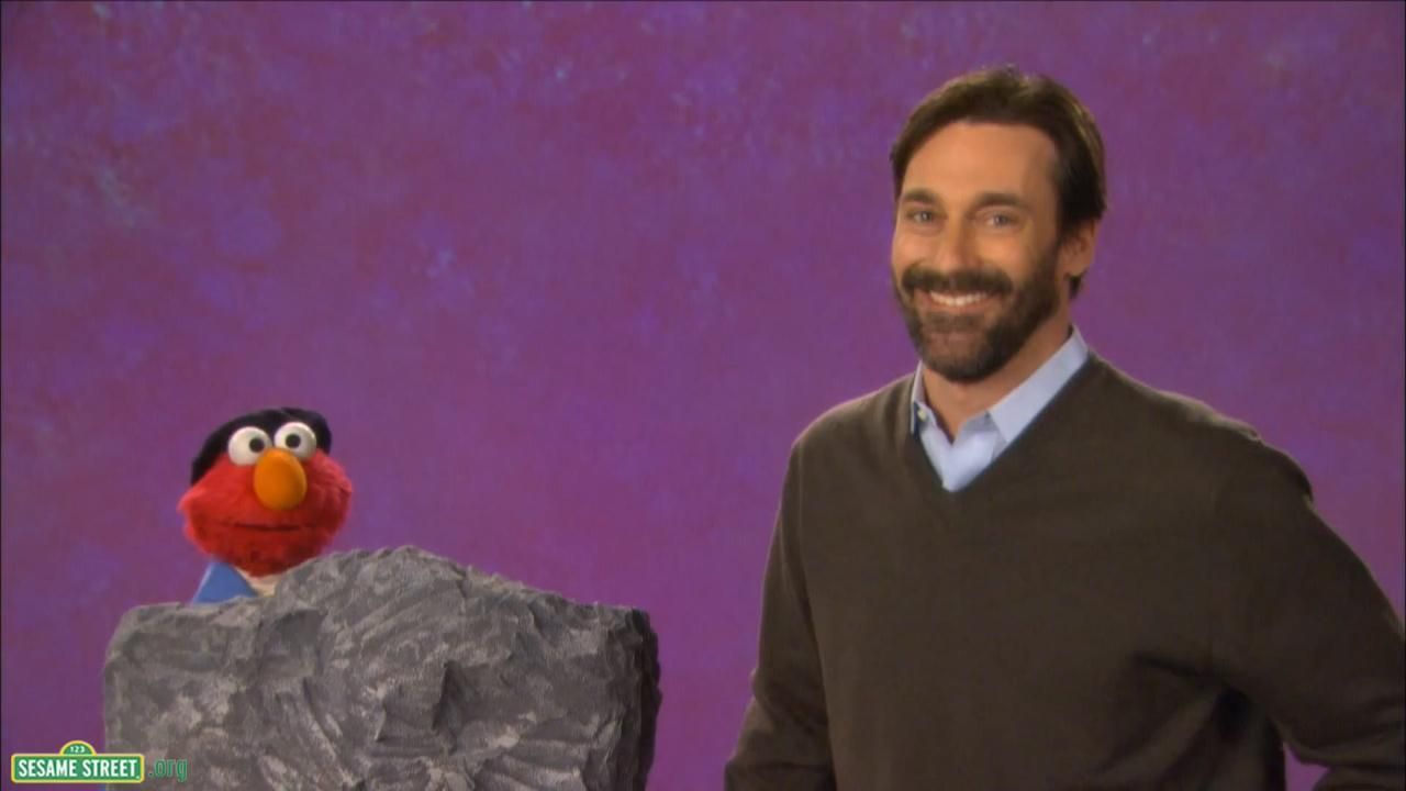 Jon Hamm and Elmo in a still from a YouTube clip of Sesame Street which was released on April 16, 2013.