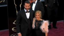 Bradley Cooper walks the red carpet with his mother at the 2013 Oscars on Sunday, Feb. 24. - Provided courtesy of OTRC