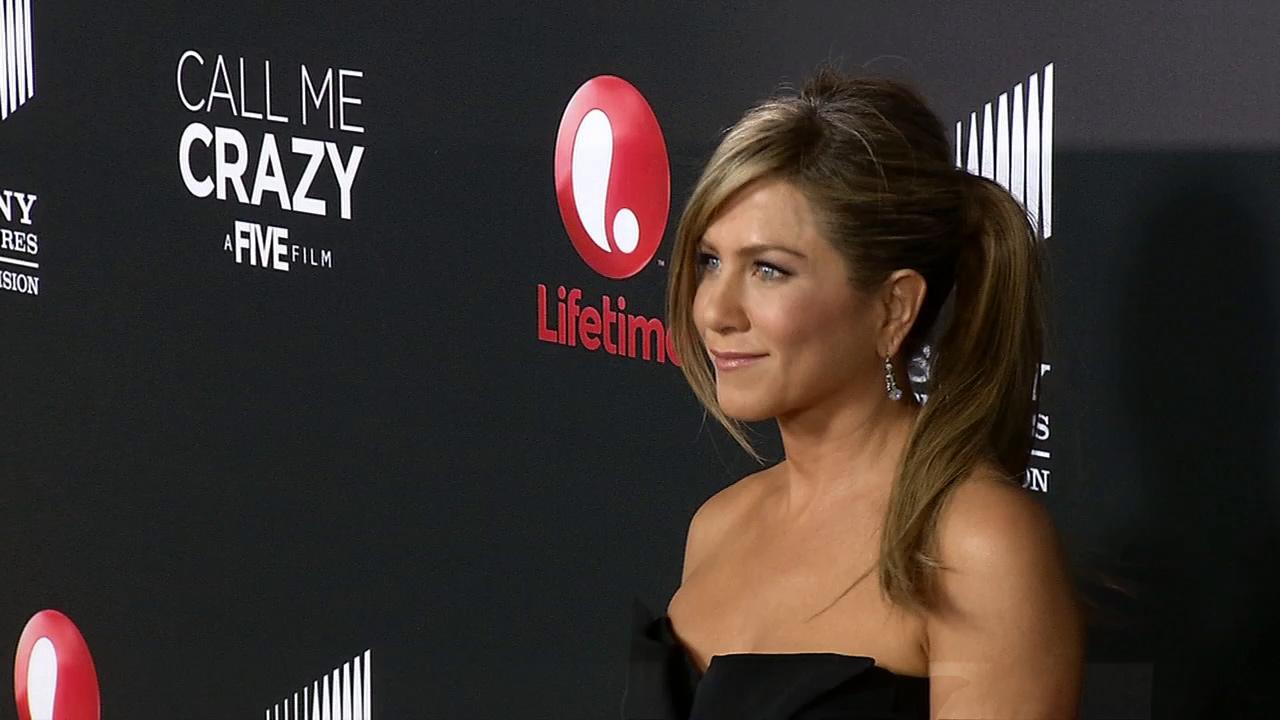 Jennifer Aniston walks the red carpet at a screening of Lifetime Televisions Call Me Crazy in Los Angeles on April 16, 2013.
