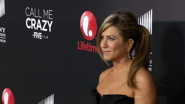 Jennifer Aniston walks the red carpet at a screening of Lifetime Televisions Call Me Crazy in Los Angeles on April 16, 2013. - Provided courtesy of OTRC