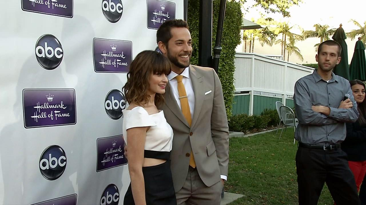 Alexis Bledel, wearing a new engagement ring from fiance Vincent Kartheiser, poses with Zachary Levi on the red carpet at the premiere of the Hallmark TV film Remember Sunday in Los Angeles on April 17, 2013.
