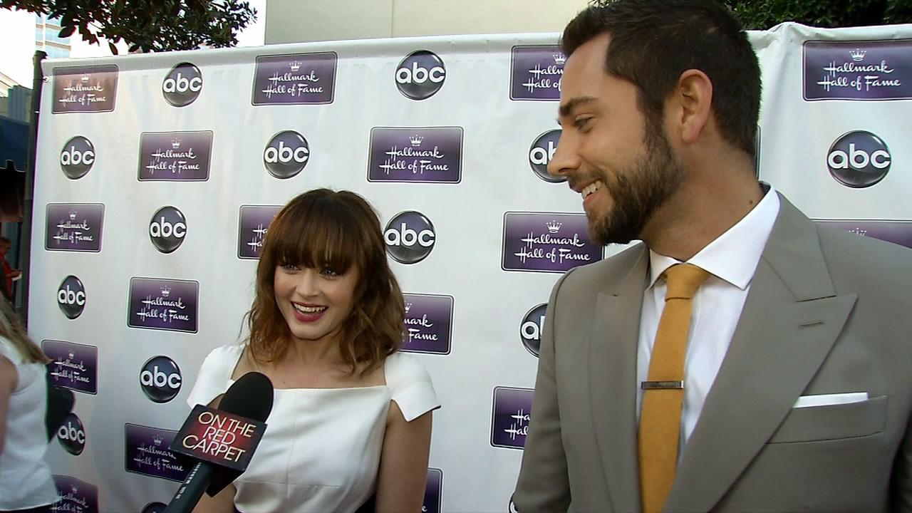 Alexis Bledel, wearing a new engagement ring from fiance Vincent Kartheiser, and Zachary Levi talks to OTRC.com at the premiere of the Hallmark TV film Remember Sunday in Los Angeles on April 17, 2013.