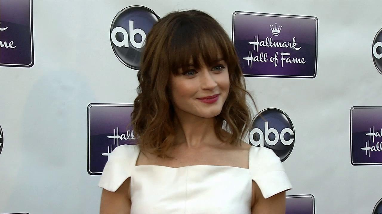 Alexis Bledel, wearing a new engagement ring from fiance Vincent Kartheiser, poses on the red carpet at the premiere of the Hallmark TV film Remember Sunday in Los Angeles on April 17, 2013.