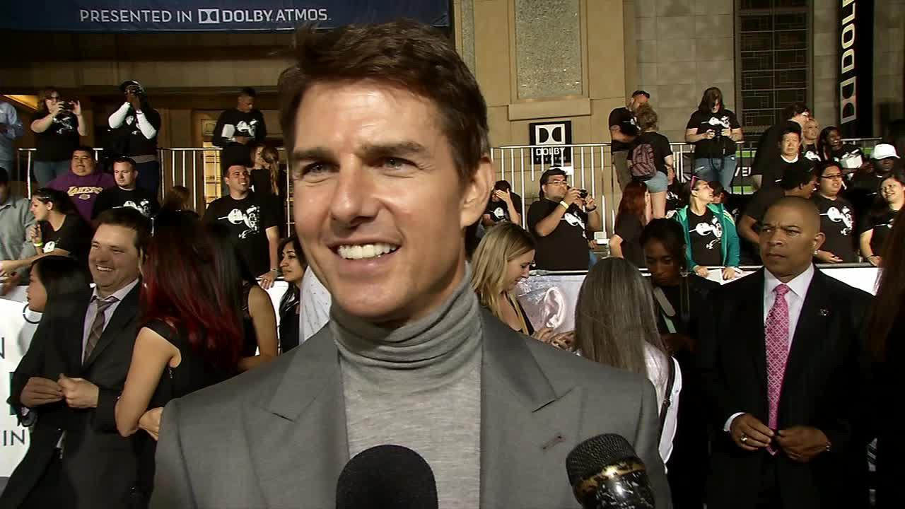 Tom Cruise talks to OTRC.com at the premiere of Oblivion in Los Angeles on April 10, 2013.