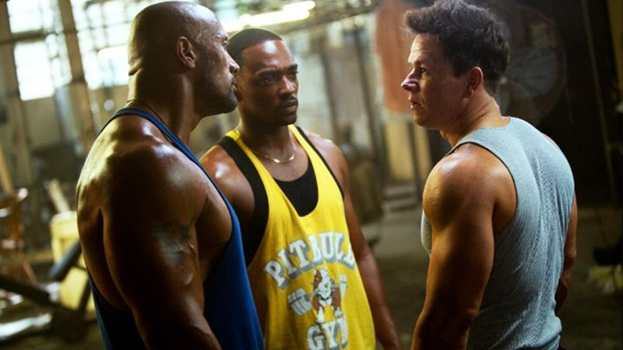 Mark Wahlberg, Dwayne Johnson and Anthony Mackie appear in a scene of the 2013 movie Pain & Gain.