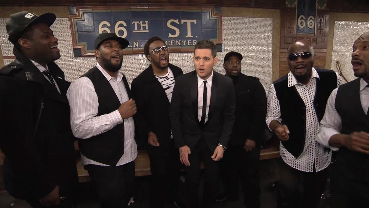 Michael Buble appears in a video posted on his YouTube page that shows him and vocal group Naturally 7 performing in a New York City subway station on April 25, 2013.