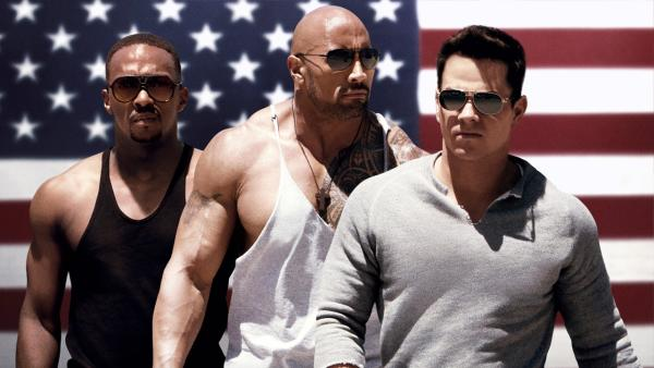 Mark Wahlberg, Dwayne Johnson and Anthony Mackie appear in a scene of the 2013 movie Pain & Gain. - Provided courtesy of Paramount Pictures