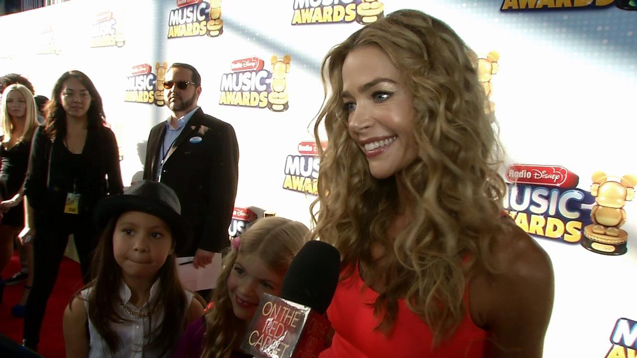 Denise Richards and daughter Lola, 7, talk to OTRC.com at the 2013 Radio Disney Music Awards at the Nokia Theatre L.A. Live on April 27, 2013. The event will air on the Disney Channel and on Radio Disney on May 4.