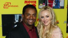 Alfonso Ribeiro, left, and Angela Unkrich attend the premiere of Movie 43 in Los Angeles on Wednesday, Jan. 23, 2013. - Provided courtesy of Matt Sayles / Invision / AP