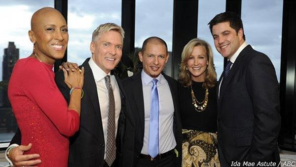 Sam Champion stands with Rubem Robierb on their wedding day at his New York apartment on Dec. 21, 2012, along with 'GMA' colleagues Robin Roberts (left), Sam Elliot (far right) and Lara Spencer (second from right).