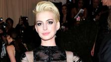 Anne Hathaway attends The Metropolitan Museum of Arts Costume Institute benefit celebrating PUNK: Chaos to Couture on Monday May 6, 2013 in New York. - Provided courtesy of Charles Sykes/Invision/AP
