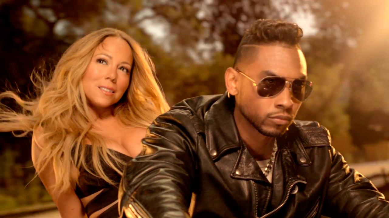 Mariah Carey and Miguel appear in a scene from the music video for #Beautiful, which was released on May 10, 2013.