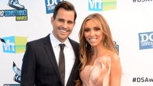 E! host Giuliana Rancic and husband Bill Rancic arrive at the 2012 Do Something Awards at Barker Hangar on August 19, 2012 in Santa Monica, California. - Provided courtesy of Jason Merritt / Getty Images
