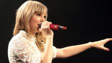 Taylor Swift performs onstage during her Red Tour at the Verizon Center on Saturday, May 11, 2013, in Washington D.C. - Provided courtesy of Owen Sweeney/Invision/AP