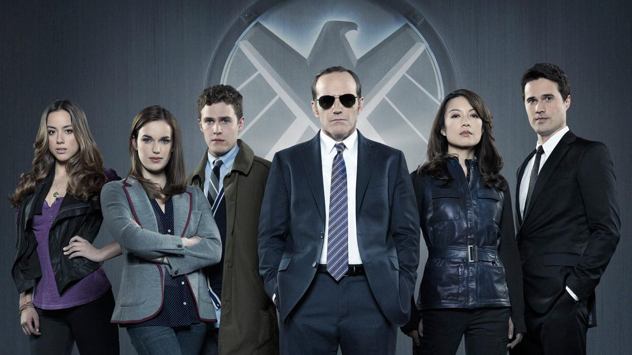 Chloe Bennet, Elizabeth Henstridge, Iain De Caestecker, Clark Gregg, Ming-Na Wen and Brett Dalton appear in a 2013 promotional photo for S.H.I.E.L.D.