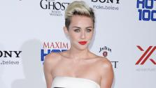 Singer and actress Miley Cyrus arrives at the 2013 Maxim Hot 100 celebration at Vanguard on Wednesday, May 15, 2013 in Los Angeles. - Provided courtesy of AP / Dan Steinberg/Invision/AP