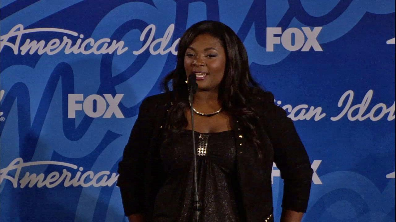 Candice Glover talks to reporters backstage after the American Idol season 12 finale on May 16, 2013. She beat Kree Harrison to win the title.