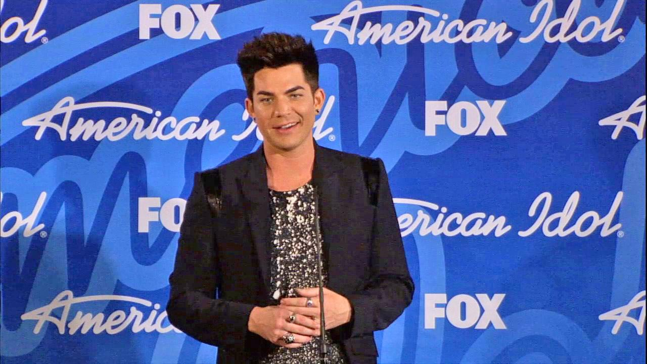 Former finalist and glam rocker Adam Lambert talks to reporters backstage after the American Idol season 12 finale on May 16, 2013. Candice Glover beat Kree Harrison to win the title.
