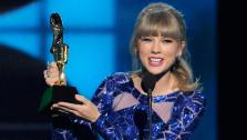 Taylor Swift accepts the award for top Billboard 200 album for Red at the Billboard Music Awards at the MGM Grand Garden Arena on Sunday, May 19, 2013 in Las Vegas. - Provided courtesy of Chris Pizzello/Invision/AP