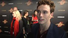 Sam Claflin talks about The Hunger Games: Catching Fire at the 2013 Cannes Film Festival on May 18, 2013. - Provided courtesy of none / Lionsgate