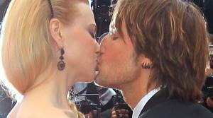 Nicole Kidman and Keith Urban kiss on the red carpet at the Cannes Film Festival on May 19, 2013. Kidman, dressed in a leaf-printed LWren Scott gown, is a member of the festivals jury. She and Urban attended a screening of Inside Llewyn Davis. - Provided courtesy of Joel Ryan / Invision / AP