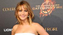 Actress Jennifer Lawrence poses for photographers at the Hunger Games Party in Cannes, southern France, Saturday May 18, 2013. - Provided courtesy of AP Photos/Anthony Harvey