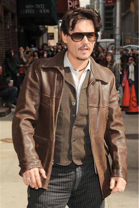 "<div class=""meta image-caption""><div class=""origin-logo origin-image ""><span></span></div><span class=""caption-text"">Johnny Depp, wearing a brown jacket and the engagement ring he initially gave fiancee Amber Heard -- a 'chick's ring' -- arrives to a taping of 'The Late Show with David Letterman' in New York on April 3, 2014. (Bill Davila / Startraksphoto.com)</span></div>"
