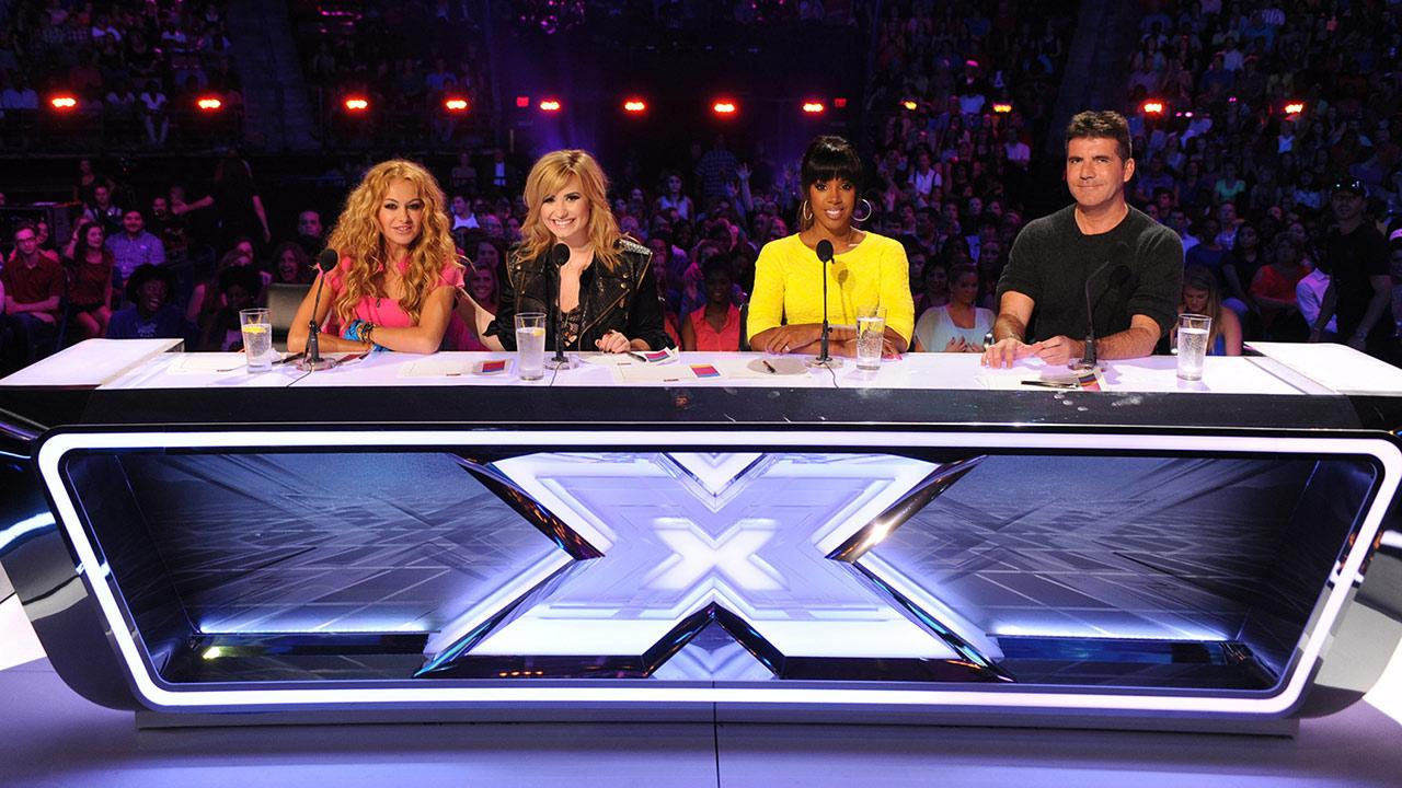 L-R: Paulina Rubio, Demi Lovato, Kelly Rowland and Simon Cowell sit at the judges table for season 3 of the FOX series The X Factor.