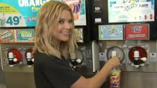 Actress Ashley Benson, of ABC Familys hit TV show Pretty Little Liars, sips a Slurpee at a 7-Eleven to promote and celebrate 7-Elevens #Awesummer Summer Slurpee Days on May 22, 2013 in Los Angeles, California. - Provided courtesy of AP / Jonathan Leibson / Getty Images for 7-Eleven
