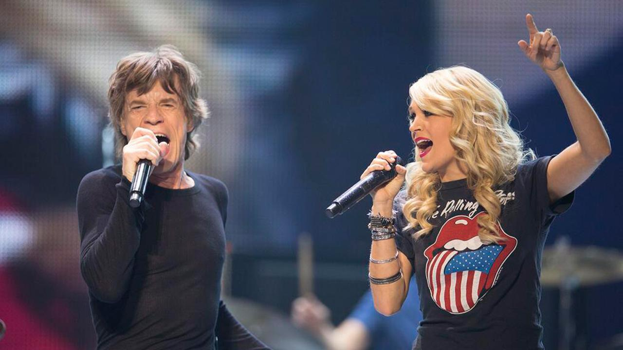 Mick Jagger performs with Carrie Underwood at a Rolling Stones concert at Torontos Air Canada Centre in Toronto, Canada on May 25, 2013.