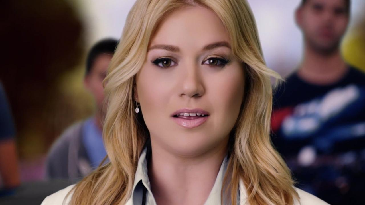 Kelly Clarkson appears in a scene from her 2013 music video, People Like Us.