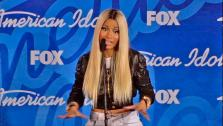 Nicki Minaj talks to reporters backstage after the American Idol season 12 finale on May 16, 2013. Candice Glover beat Kree Harrison for the title. - Provided courtesy of FOX
