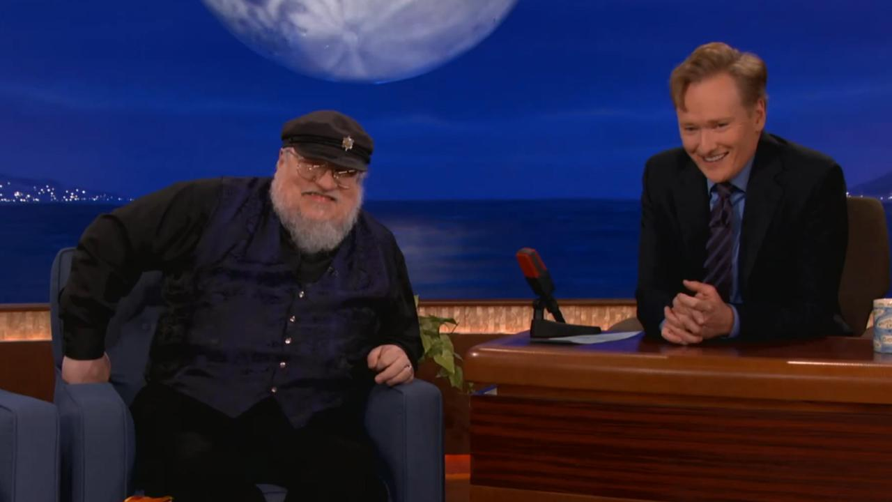 George R.R. Martin appears on Conan alongside Conan OBrien on June 5, 2013.