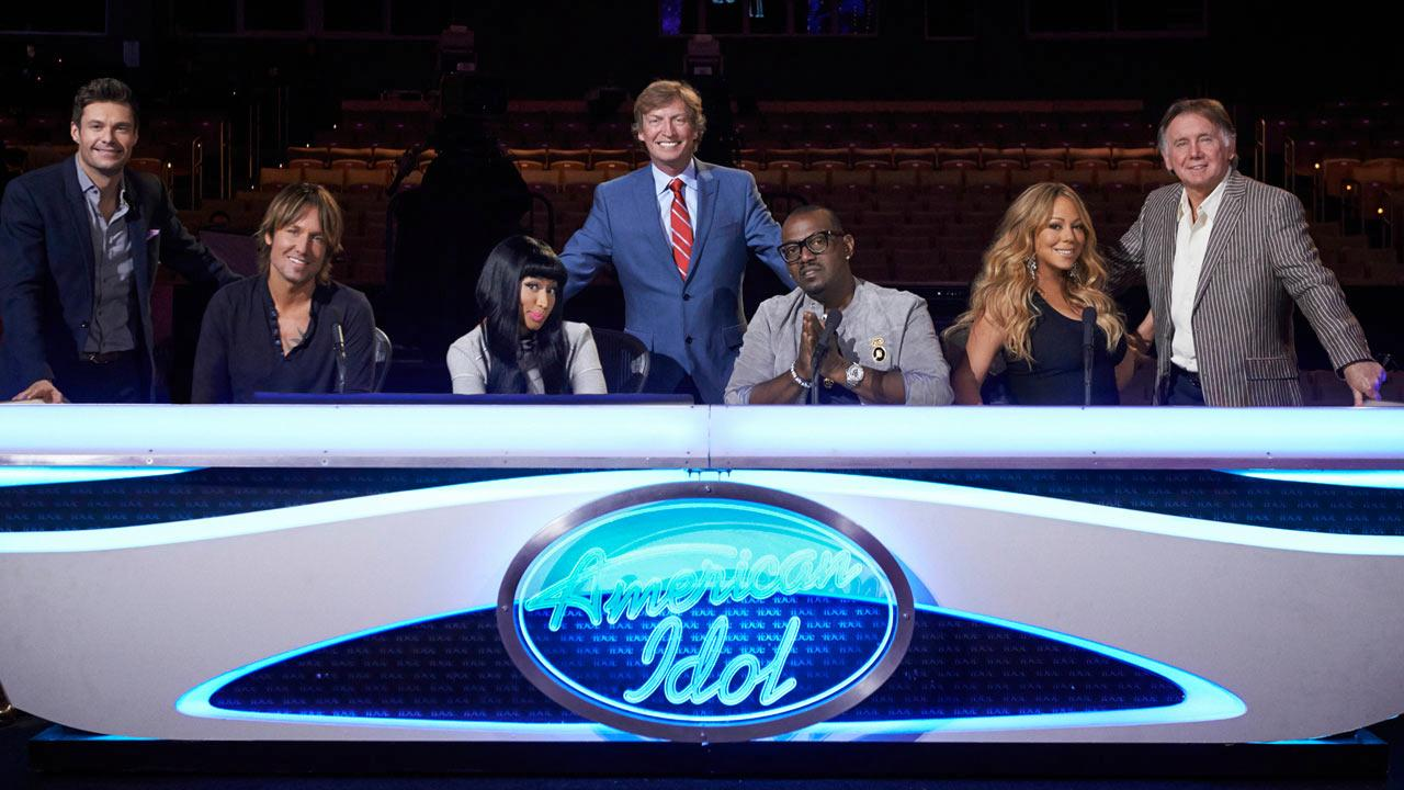 L-R: Ryan Seacrest, Keith Urban, Niki Minaj, Nigel Lythgoe, Randy Jackson, Mariah Carey and Ken Warwick appear in an undated promotional photo for American Idol season 12.